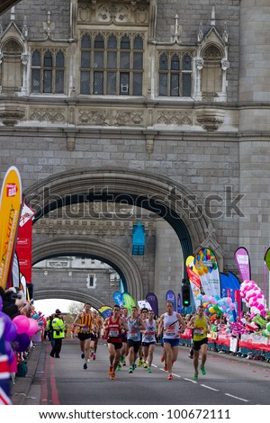 LONDON, UK - APRIL 22: Tens of thousands of runners pass tower bridge during the london 2012 marathon on the April 22 in London, UK - stock photo