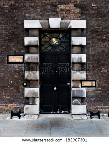 LONDON, UK - APRIL 07, 2012: The front door of the Parliamentary Counsel Office on Whitehall, the parliamentary counsel are responsible for drafting all UK government legislation.  - stock photo