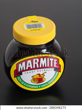 LONDON, UK â?? APRIL 9, 2015: The quintessential British spread, Marmite is now 113 years old. Based on yeast extract, it contains a wide range of vitamins including B1, B2 and B12. - stock photo