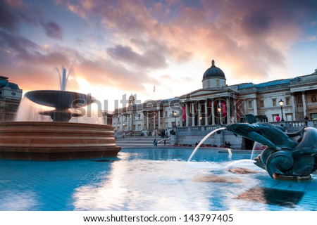 LONDON, UK - APRIL 30: Tourists visit Trafalgar Square on April 30, 2013 in London. The capital of UK is one of the most popular tourist attraction on Earth, with more than 15 million visitors a year - stock photo
