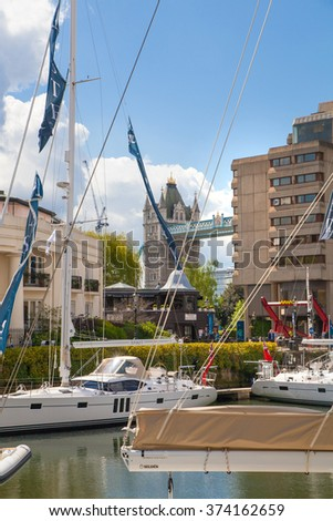 LONDON, UK - APRIL 22, 2015:  Tower bridge and st. Katherine dock with boats
