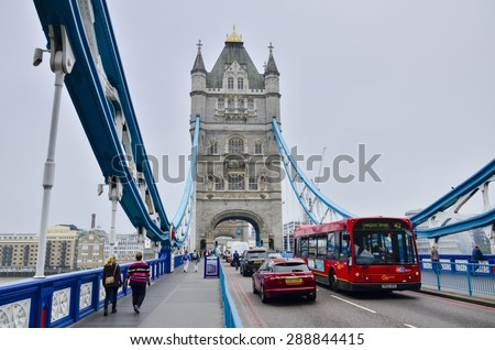 LONDON, UK - APRIL15, 2015: Tower bridge in cloudy day. City of London, south bank of river Thames - stock photo