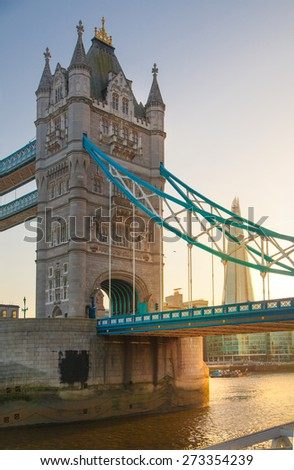 LONDON, UK - APRIL15, 2015: Tower bridge in sunset. City of London, south bank of river Thames walk. - stock photo