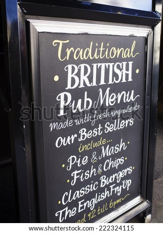LONDON, UK - APRIL 16, 2014: Traditional British Pub Menu. Advertising in front of a pub. - stock photo