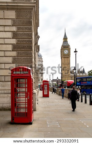 LONDON, UK - APRIL 2014: Traditional London Red Telephone Booth and with Big Ben on backgrounf.  - stock photo