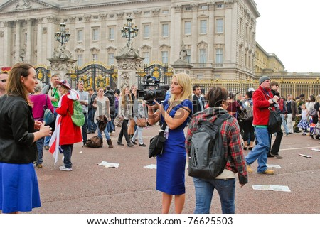 LONDON, UK - APRIL 29: TV reporters at Prince William and Kate Middleton wedding, April 29, 2011 in front of Buckingham Palace in London, United Kingdom - stock photo