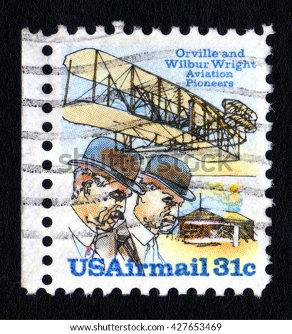 London, UK, April 5 2008 - Vintage 1978 United States of America cancelled postage stamp showing the Wight Brothers commemorating the 75th anniversary of powered flight - stock photo