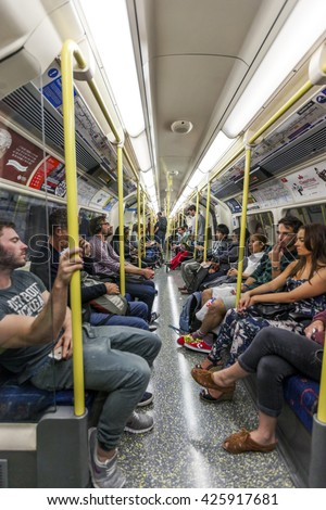LONDON, UK - AUG 24, 2014: People sitting on an underground train in London during rush hour.  - stock photo