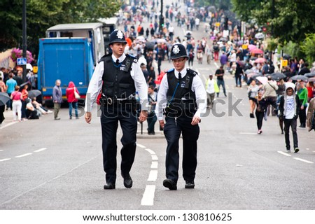 LONDON, UK - 27 AUG: Two police officers patrol the streets during the Notting Hill Carnival in London on August 27, 2012.