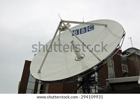 LONDON, UK - AUGUST 18, 2007:  A large satellite dish at BBC Television Centre in Shepherd's Bush, West London.  The broadcasting organisation transmits programmes around the world.   - stock photo