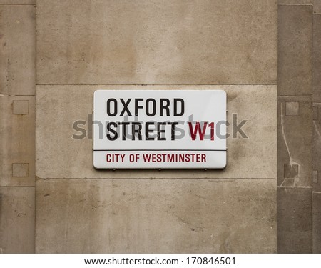 LONDON, UK - AUGUST 6, 2013: A sign on a street wall for Oxford Street in Central London - stock photo