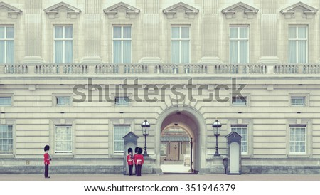 London, UK â?? August 16,, 2012: Buckingham Palace the official residence of Queen Elizabeth II. Entrance and main gate with guard - stock photo
