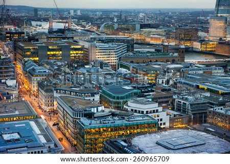 LONDON, UK - AUGUST 9, 2014. Busy streets and first night light. London's panorama in sunset from St. Paul cathedral. - stock photo