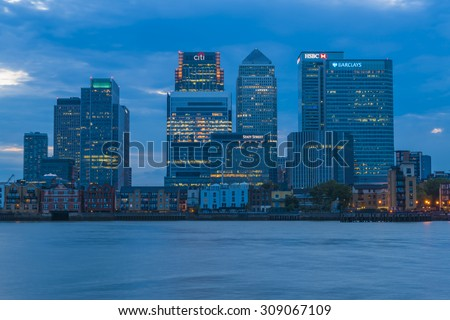 LONDON, UK - AUGUST 22, 2015:Evening view of Canary Wharf, a major business district located in London, UK. It's a home to the headquarters of numerous major banks and other professional service firms - stock photo