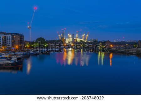 LONDON, UK - August 2nd 2014: Millennium Dome at night, view from Canary Wharf. It was built  to house an exhibition celebrating the beginning of the third millennium. It's now a key feature of The O2