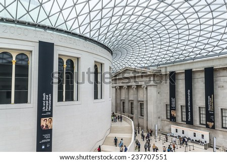 LONDON, UK - AUGUST 18, 2013: People visiting the main court of British Museum - museum of human history and culture and one of the top attractions of London. British Museum was established in 1753. - stock photo