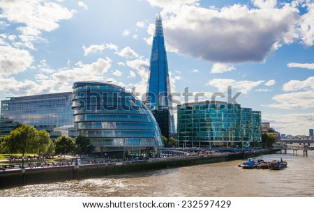 LONDON, UK - AUGUST 16, 2014: Shard of glass on river Thames. Modern London architecture - stock photo