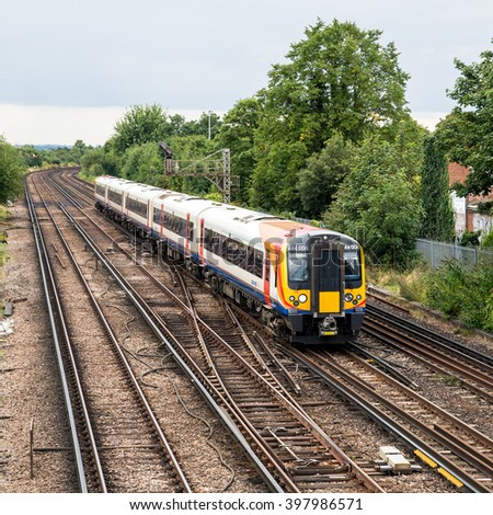 London, UK, 31 August 2014.  South West Trains commuter service heading towards the city. Increasing rail fares are of major concern in the UK.   - stock photo