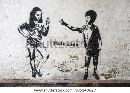 LONDON, UK - AUGUST 7TH 2015: Rude Kids Graffiti in London, on 7th August 2015. - stock photo