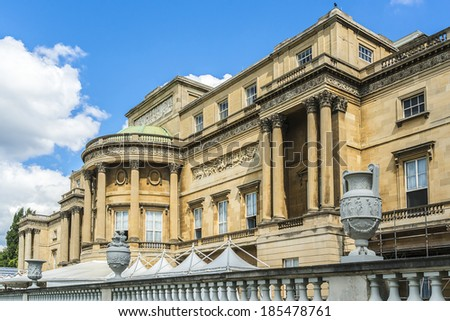 LONDON, UK - AUGUST 11, 2013: Vases in courtyard of Buckingham Palace - famous landmark in London. Built in 1705, Palace is official London residence and principal workplace of British monarch. - stock photo
