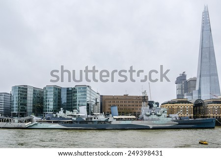 LONDON, UK - AUGUST 11, 2013: View of River Thames waterfront with Shard building in background. Shard (Architect Renzo Piano, 2012) - Glass-clad pyramidal tower, tallest building in European Union. - stock photo