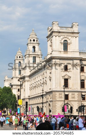 LONDON, UK - AUGUST, 2012: View of typical street with tourists in Central London on a sunny day - stock photo