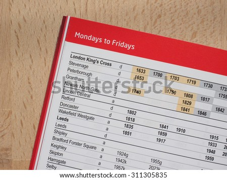 LONDON, UK - CIRCA AUGUST 2015: Northbound trains from London listed on a paper timetable