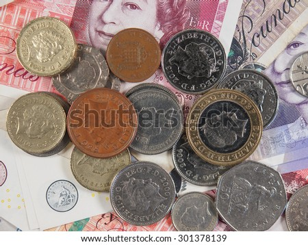 LONDON, UK - CIRCA JULY 2015: Sterling pound GBP banknotes and coins, currency of the United Kingdom - stock photo