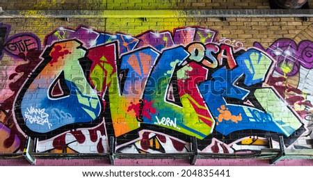 LONDON, UK / CIRCA JUNE 2014 - Colorful graffiti made by unknown artist seen on Leake Street public gallery - stock photo