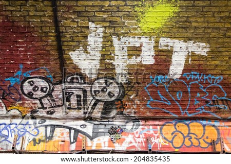 LONDON, UK / CIRCA JUNE 2014 - Graffiti vintage projector made by unknown artist seen on Leake Street public gallery - stock photo