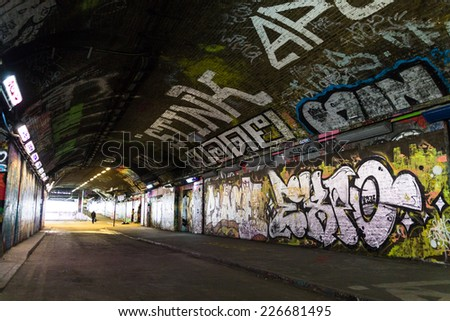 LONDON, UK / CIRCA OCTOBER 2014 - Graffiti covered tunnel by unknown artists, seen on Leake Street public gallery  - stock photo