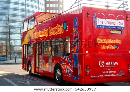 LONDON UK.  DEC  14 2005:  Double-decker bus standing at signal in central London