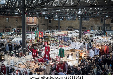 LONDON, UK - DEC 7: people visit the Old Spitalfields Market in London on December 7, 2014 on one of the busiest days of the year before Christmas. - stock photo