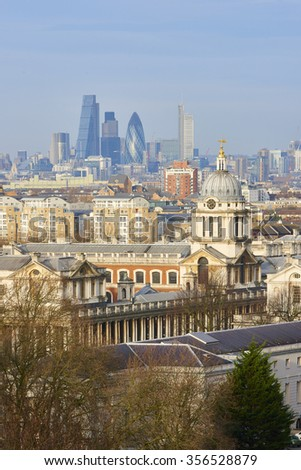LONDON, UK - DECEMBER 28: Heavily built cityscape with National Maritime museum spires in the foreground and City of London skyscrapers in the background. December 28, 2015 in London. - stock photo