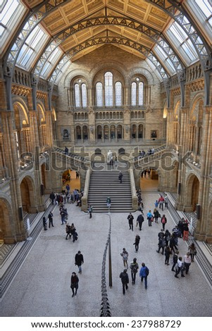 LONDON, UK - DECEMBER 11: High angle shot of staircase with statue of Charles Darwin at Natural History Museum. December 11, 2014 in London. - stock photo