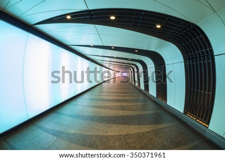 LONDON, UK - DECEMBER 12, 2015: The 90 meters long curved pedestrian tunnel features an LED integrated lightwall and links St Pancras International and King's Cross St Pancras Underground stations. - stock photo