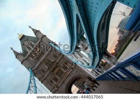 LONDON, UK - DECEMBER 21, 2005: Tower Bridge and City Hall in London, UK. The bridge crosses the River Thames close to the Tower of London and has become an iconic symbol of London - stock photo