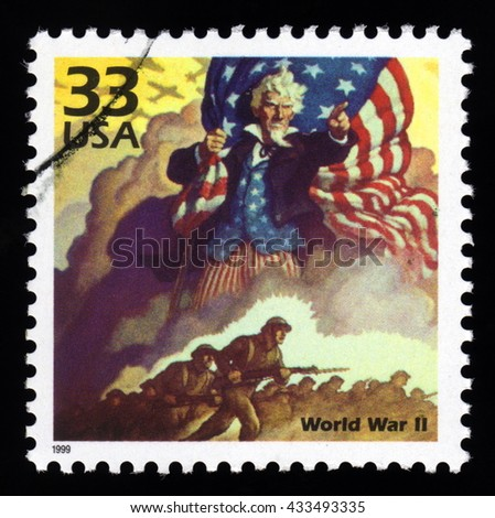 London, UK, December 7 2010 - Vintage 1999 United States of America cancelled postage stamp of World War Two with soldiers and Uncle Sam holding the Stars and Stripes - stock photo