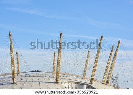 LONDON, UK - DECEMBER 28: Visitors at top of O2 Centre, formerly known as Millennium Dome, in a sunny blue sky day. December 28, 2015 in London. - stock photo