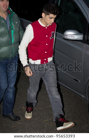 LONDON, UK - FEB. 20: Singers from One direction arrive at  the BBC Maida Vale Studios in London on the Feb 20, 2012 in London, UK - stock photo