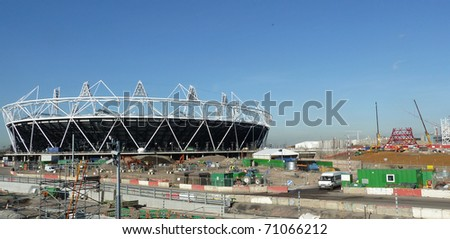 LONDON, UK- FEBRUARY 8: The Olympic Stadium under construction, with Anish Kapoor's The Orbit Tower being built in the background. February 8, 2011 in London UK. - stock photo
