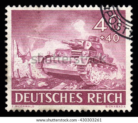 London, UK, February 5 2011 - Vintage 1943 Germany cancelled postage stamp with an engraving  of a German Third Reich Tank - stock photo