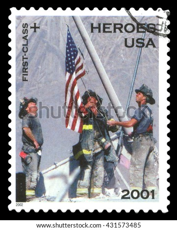 London, UK, February 5 2012 - Vintage 2001 United States of America cancelled postage stamp  showing the fire department heroes of the September 11 terrorist attack raising the Stars - stock photo