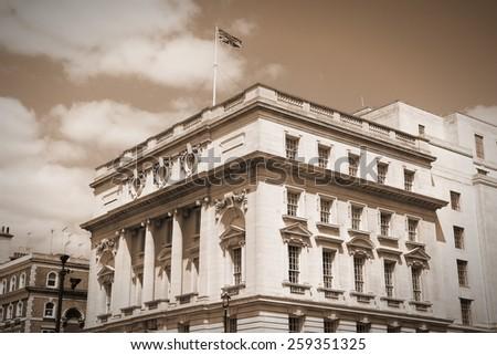London, UK - governmental building at Whitehall. British flag. Sepia tone - filtered vintage photo style. - stock photo
