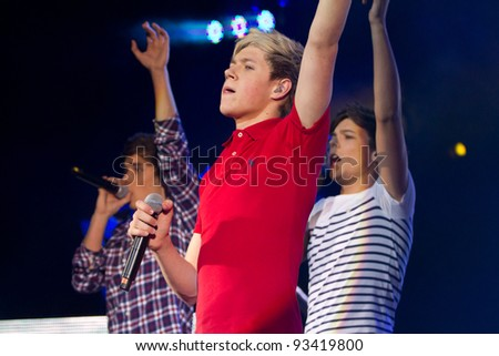 LONDON, UK - JAN. 23: One Direction Play the HMV Apollo in London on the January 23, 2012 in London, UK - stock photo
