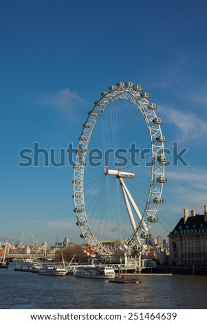 London, UK - January 30, 2015: A view of London Eye from Westminster Bridge on Jan 30, 2015. It is the tallest Ferris wheel in Europe, and the most popular tourist attraction in the United Kingdom. - stock photo