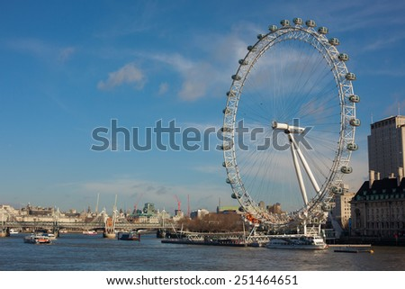London, UK - January 30, 2015: A view of London Eye from Westminster Bridge on Jan 30, 2015. It is the tallest Ferris wheel in Europe, and the most popular tourist attraction in the United Kingdom.