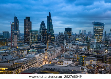 LONDON, UK - JANUARY 27, 2015: Busy streets of City of London, business and banking aria. London's panorama in sun set. View from the St. Paul cathedral - stock photo