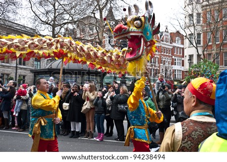 LONDON, UK-JANUARY 29: Chinese Dragon dancers take to the streets in a parade, part of the famous London celebrations for the year of the dragon, January 29, 2012 in London UK - stock photo