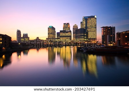 London, UK - January 31 2011: Looking towards Canary Wharf over Blackwall Basin, London.